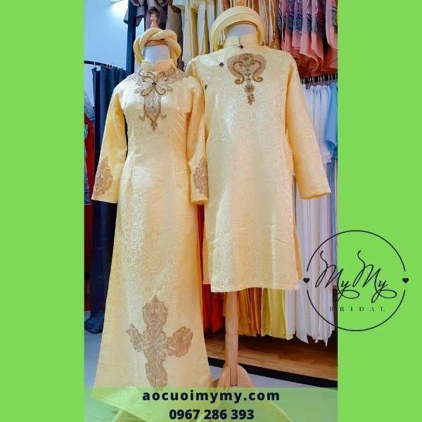 Áo dài cô dâu chú rể  Gấm vàng kết hoa văn