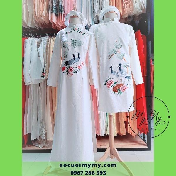 Áo dài cặp cô dâu chú rể gấm trắng thêu đôi chim hạc