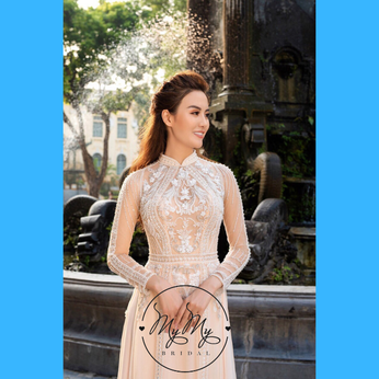 Áo dài cô dâu đính kim sa, kết hạt trai cách điệu hoa văn sang trọng