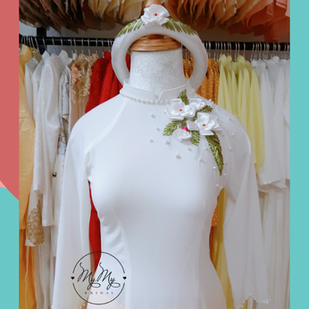 Áo dài bưng quả nền trắng đính hoa
