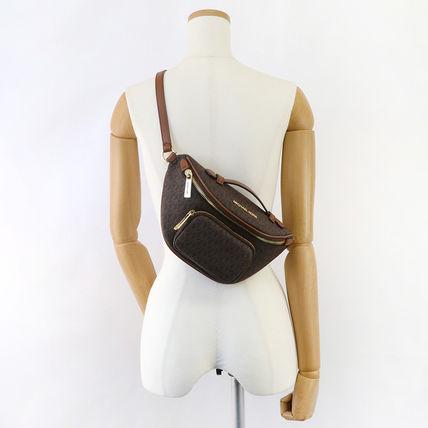 Túi xách Michael Kors authentic Usa cho nữ Erin 35F0GERN1B XS WAIST PACK XBODY,  túi xách Michael Kors cao cấp đeo chéo, túi xách MK chính hãng đeo chéo màu nâu logo dạo phố, giỏ xách MK chính hãng, giỏ xách MK hàng hiệu.