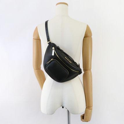 Túi xách Michael Kors authentic Usa cho nữ Erin 35F0GERN1L XS WAIST PACK XBODY LEATHER,  túi xách Michael Kors cao cấp đeo chéo, túi xách MK chính hãng đeo chéo đen dạo phố, giỏ xách MK chính hãng, giỏ xách MK hàng hiệu.