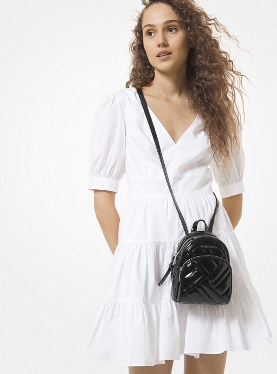 Balo mini Michael Kors hàng hiệu  Abbey Mini BKPK Xbody Black backpack, balo michael kors chính hãng đeo chéo, balo MK hàng hiệu màu đen bóng, balo Michael Kors chính hãng authentic giành cho nữ, balo michael kors authentic minisize
