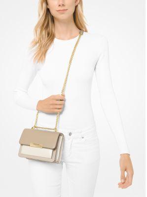 Túi xách Michael Kors hàng hiệu authentic Jade XS Suggest Crossbody Bag, túi xách MK nữ đeo chéo màu trắng, túi xách MK chính hãng dự tiệc giành cho nữ, túi xách michael kors nữ đeo chéo sành điệu, túi xách MK đeo vai màu trắng