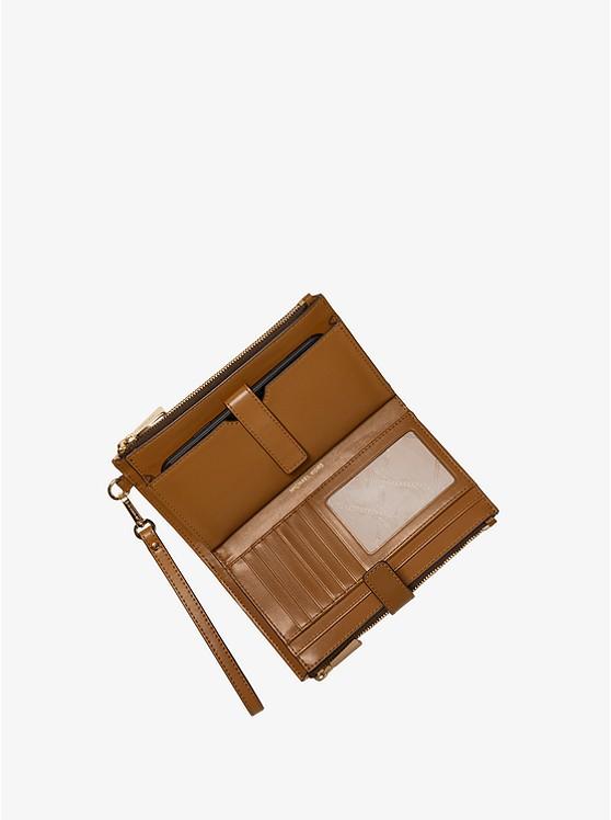 Ví cầm tay Michael Kors hàng hiệu 32T0GJ6W4O Adele Printed Logo Smartphone Wallet Brown Multi