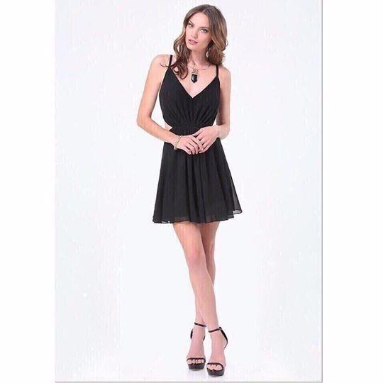 Đầm 2 dây xòe hở eo sexy