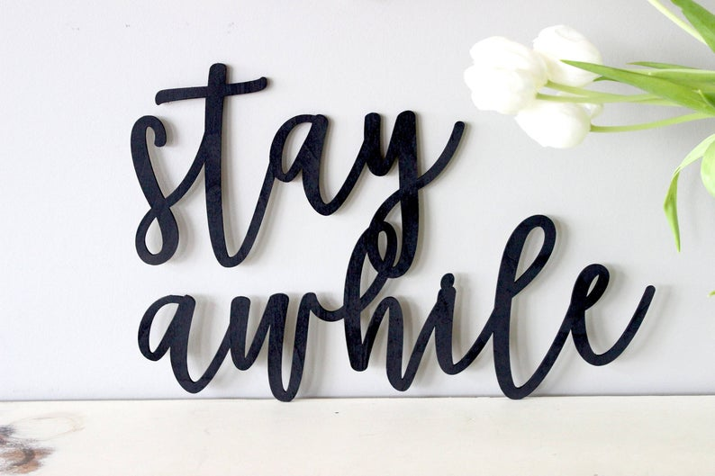Metal wall art decoration stay awhile